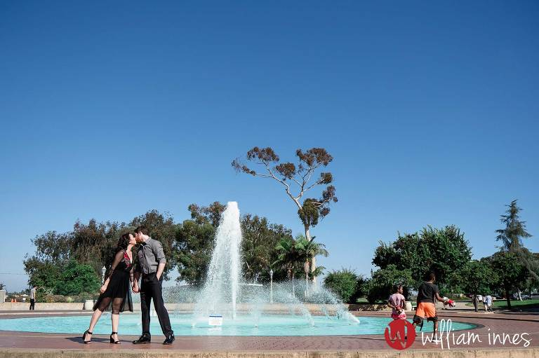 water fountain in park with couple