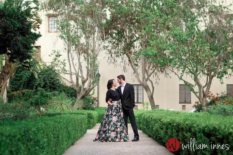 Couple embracing in a garden in Balboa park