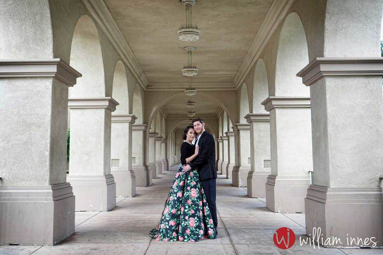couple kissing in a hall way