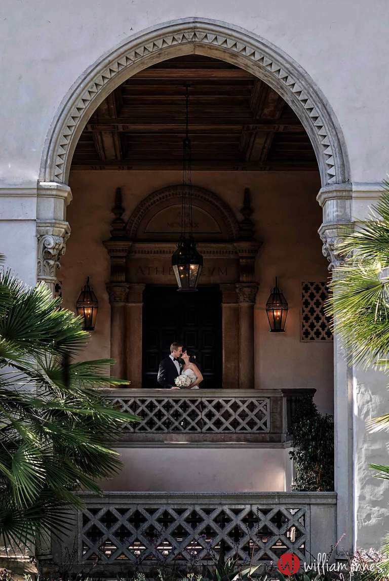 bride and groom in arch way at wedding at The Athenaeum Pasadena