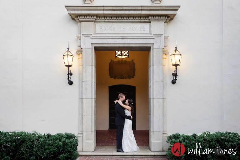 couple kissing at wedding at The Athenaeum Pasadena