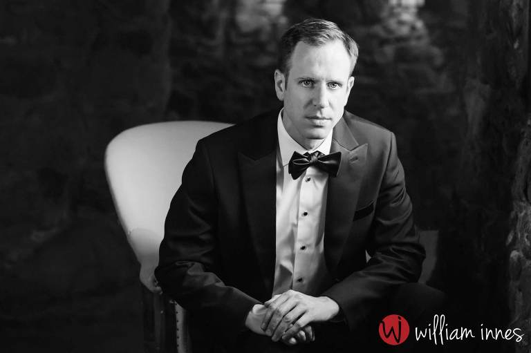 Groom sitting in chair at the Newhall Mansion