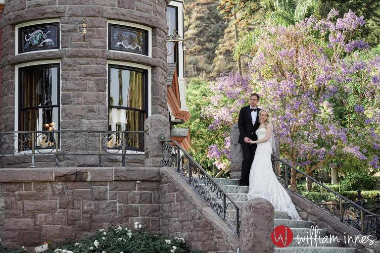 Couple standing on stairs at the Newhall Mansion