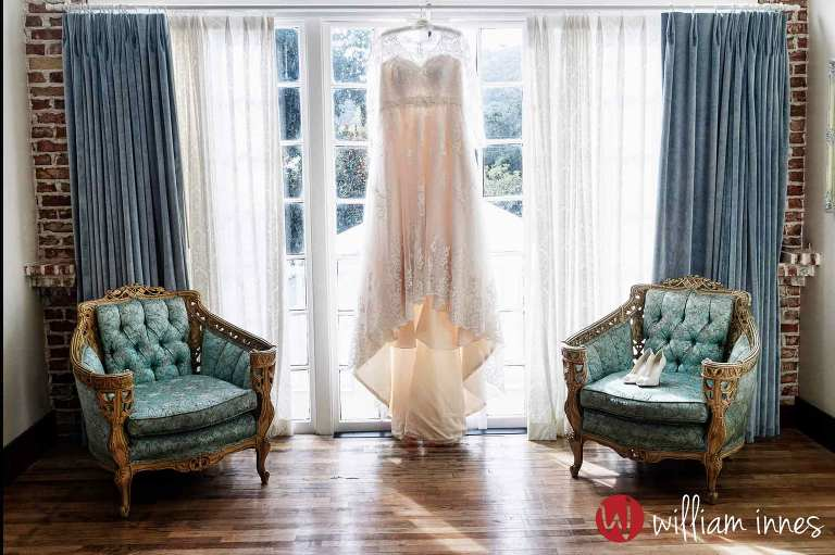 wedding gown hanging at a 1880 Union Hotel wedding