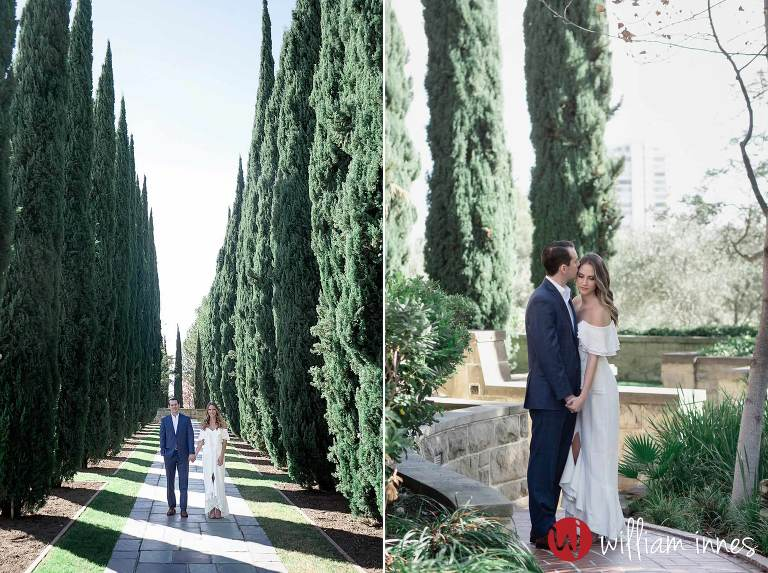 Standing in tress during a Greystone Mansion Engagement session