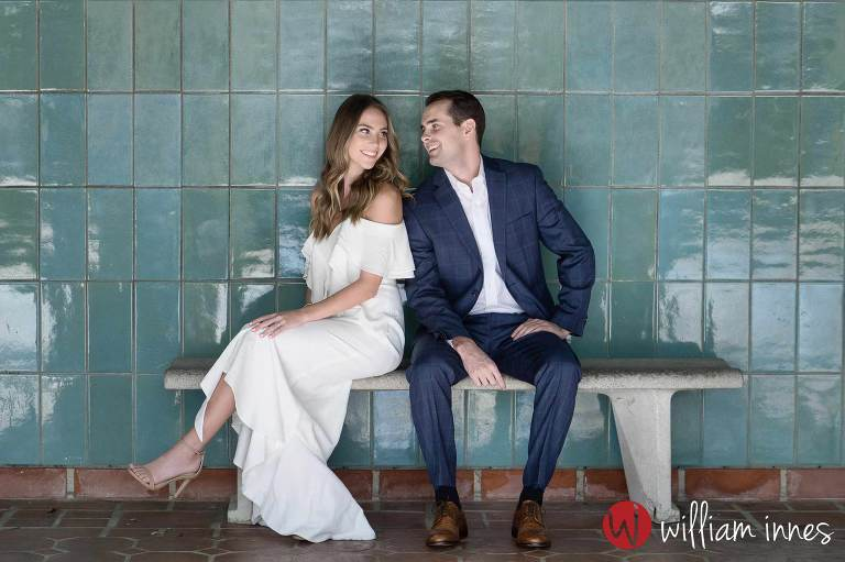 Couple sitting on a bench at a Greystone Mansion Engagement session