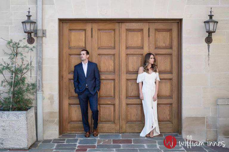 Man and women standing by door at a Greystone Mansion Engagement session